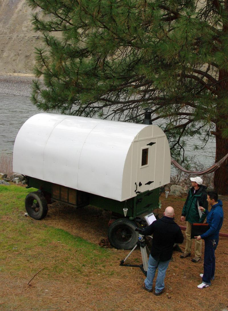Frist Sheep Wagon being filmed is parked next to beautful Idaho River , awesome