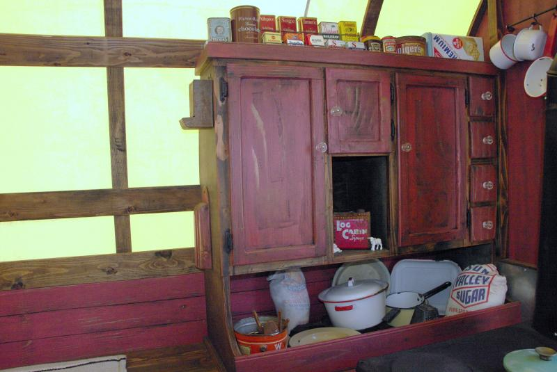 neat antique style kitchen cabiniet inside sheep wagon