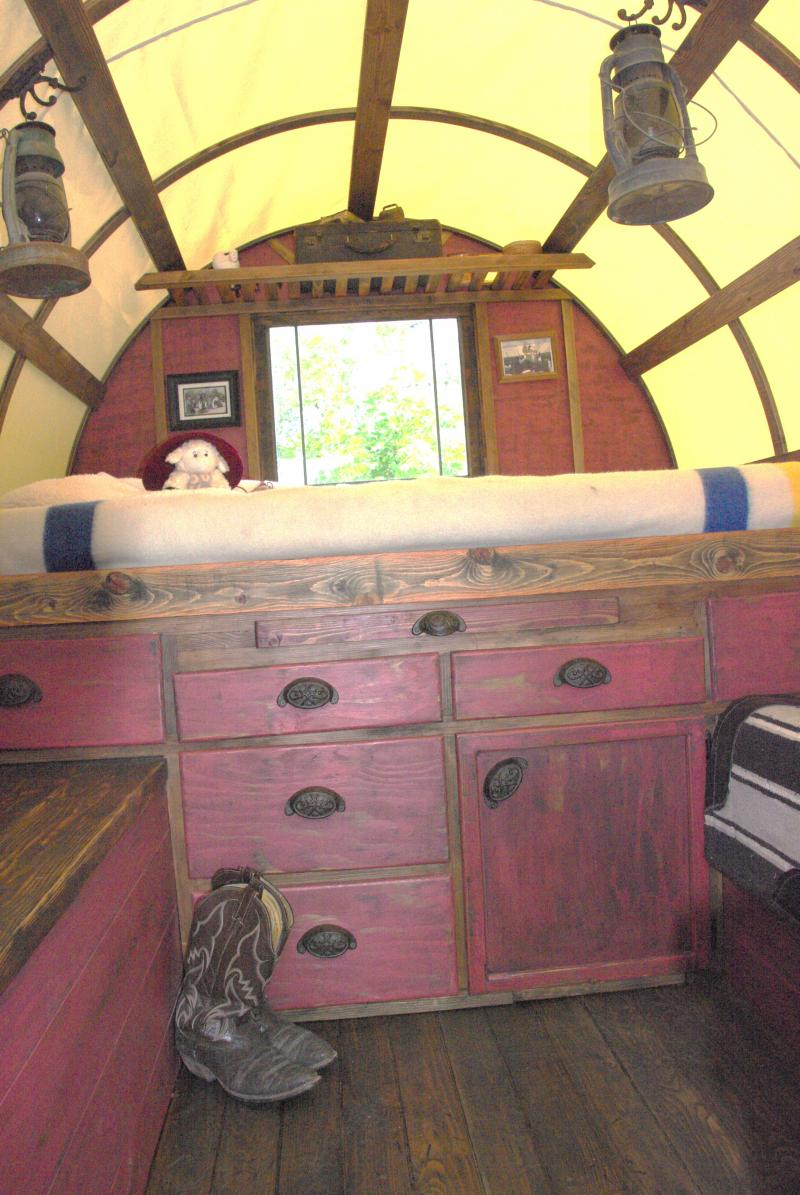 queen size bed with drawers under neat for storage inside this sheep wagon