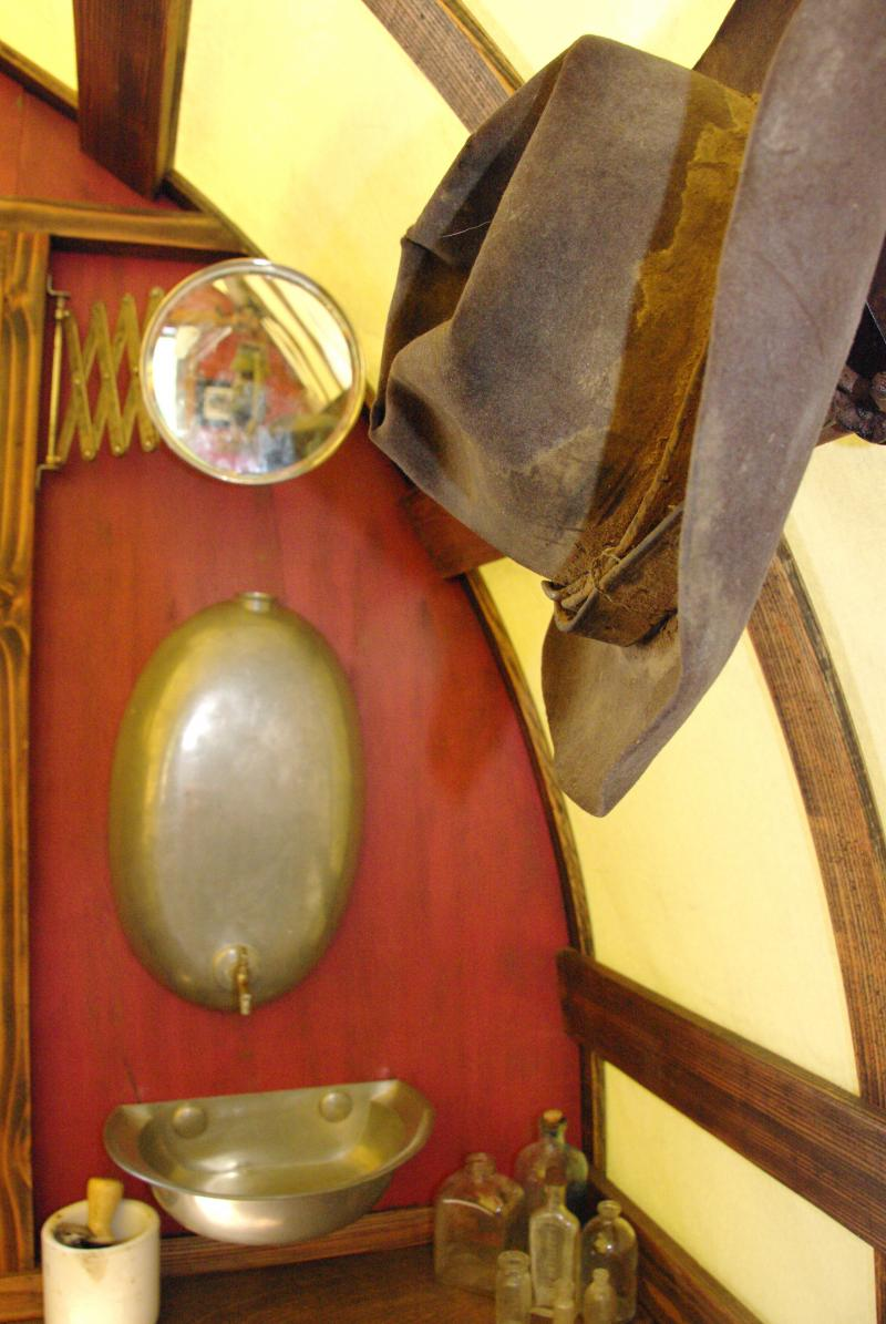 Antique sink and mirror inside this sheep wagon