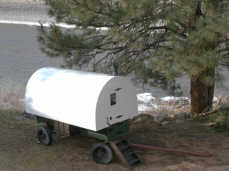 This Sheep Wagons home is setting next to a river in Idaho