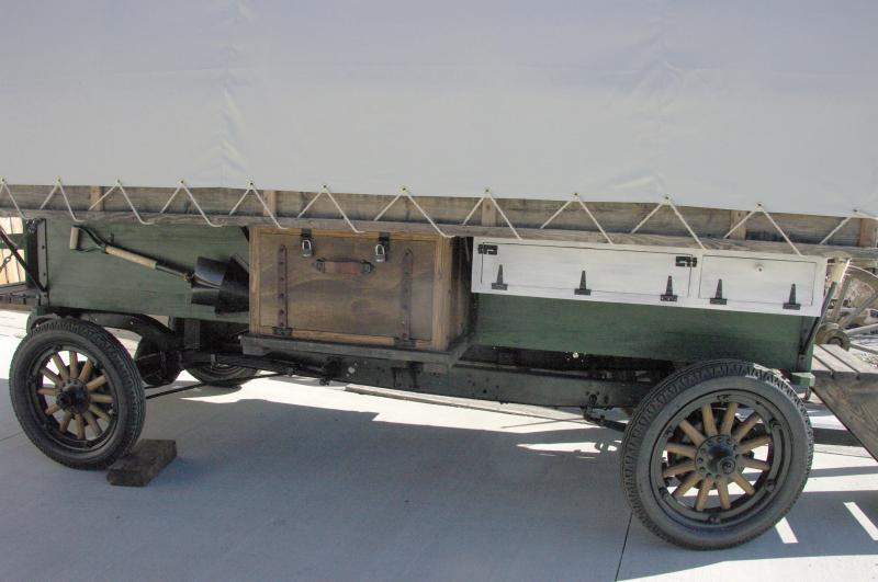 side view of out side of wagon has antique style boxes and shovel