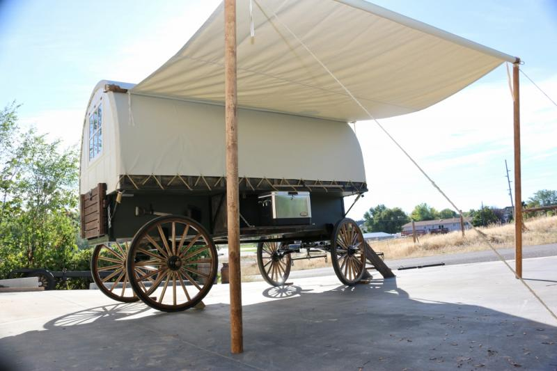 this sheep wagon built on amish woodspoke running gear with awing - Sheep Wagon